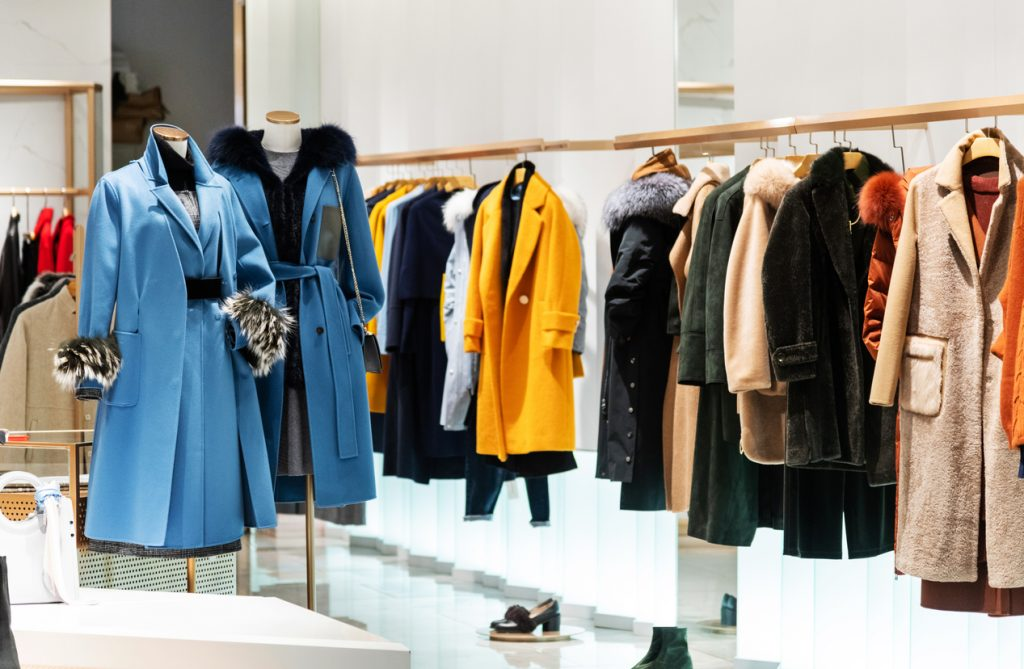 Female overcoat in modern clothing store