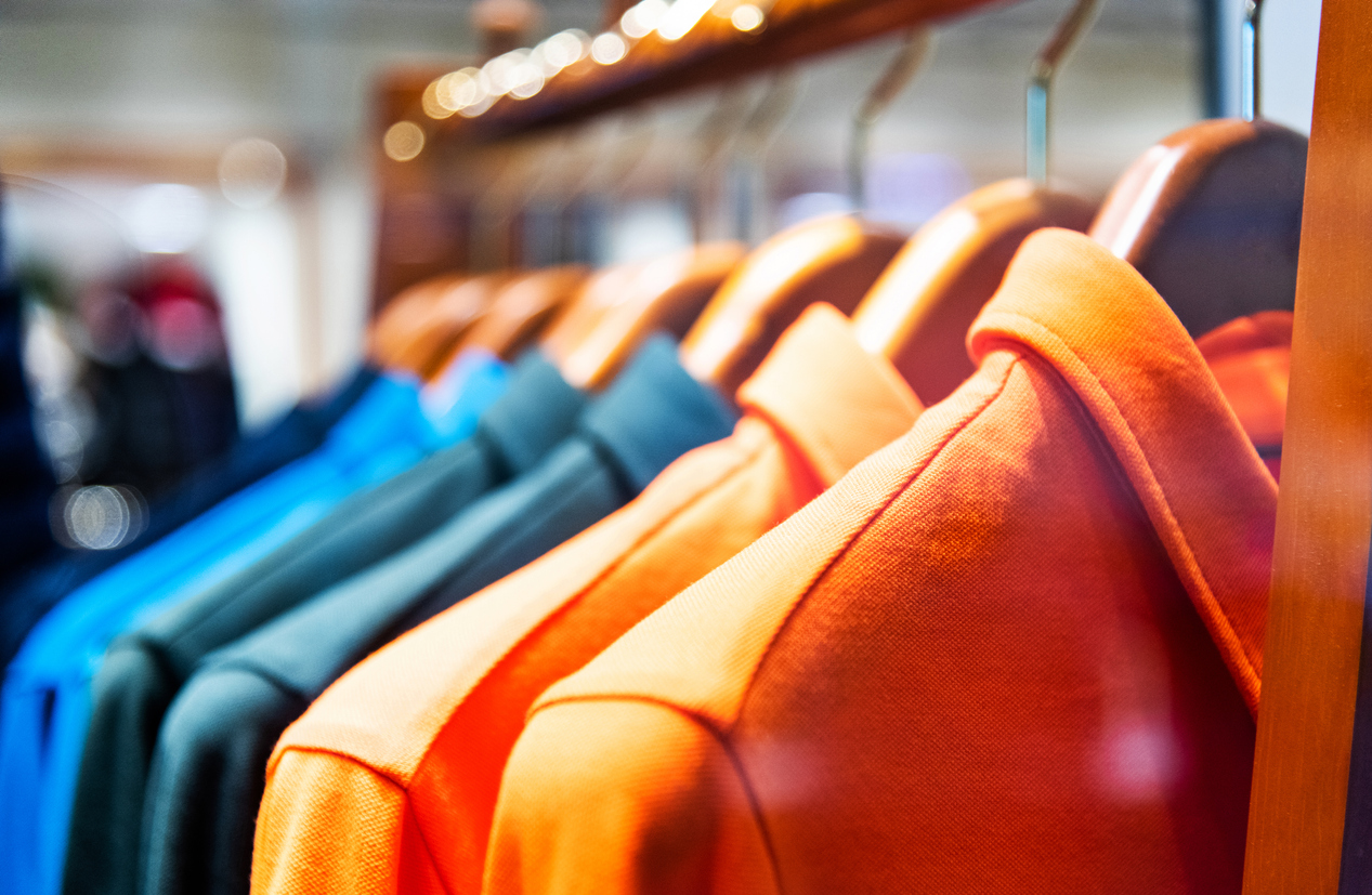 Colorful shirts in modern clothing store.