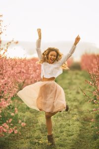 Beautiful young woman with cherry blossom at spring